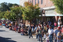 Gathering on Main Street in downtown Wendell during a town festival.