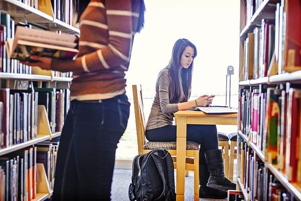 girl studying at library